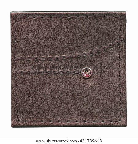 brown leather label decorated with seams and  button