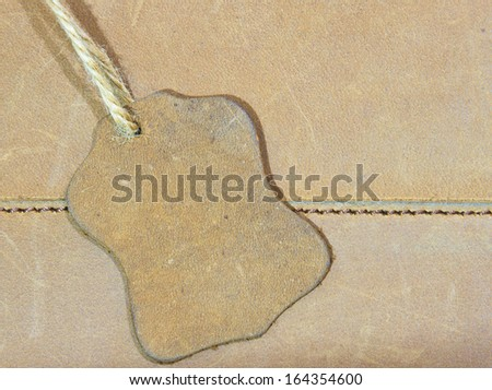 brown leather label on a brown bag - stock photo