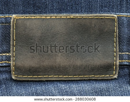 brown leather label on  jeans background