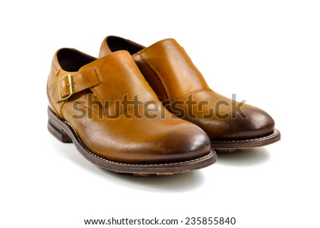 Brown leather man shoes isolated on white background, selective focus.  - stock photo