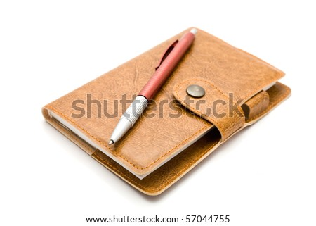 brown leather notebook with a pen on a white background
