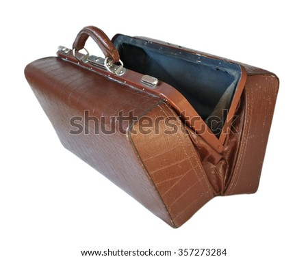 Brown leather old luggage bag open isolated on white