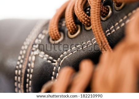 Brown leather shoe with brown lace and stitches for children