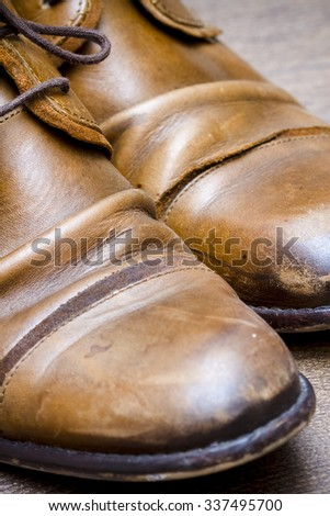 Brown leather shoes on the wooden floor  - stock photo
