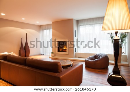 Brown leather sofa in luxury drawing room - stock photo