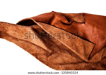 Brown Leather, Tan. Genuine. Concept and Idea of Fine Leather Crafting, Handcrafts, Handmade, Handcrafted, Leather Industry. Background Textured and Wallpaper. Rustic Style. - stock photo