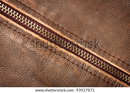 Brown leather texture and zipper background - stock photo