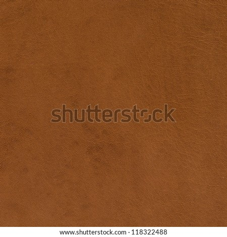 Brown leather texture closeup background. - stock photo