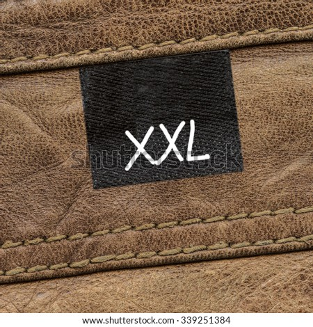 brown leather texture decorated with seams, tag, size