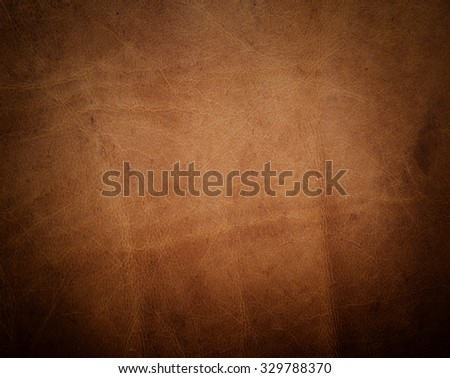 brown leather texture with dark borders. - stock photo