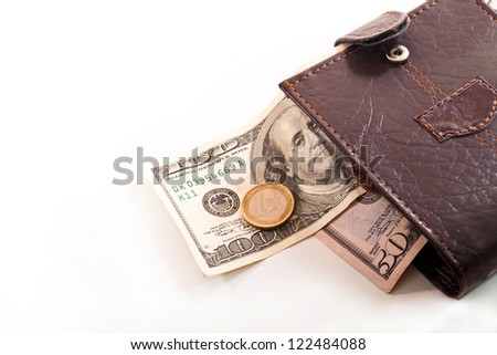 Brown leather wallet with banknotes and coins on white background