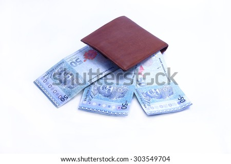 Brown leather wallet with Malaysian Ringgit  - stock photo