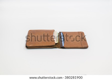 Brown leather wallet with money and credit card inside