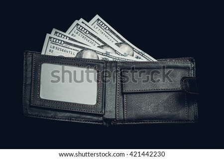 brown leather wallet with one hundred usa dollar bills. isolated. toned image - stock photo