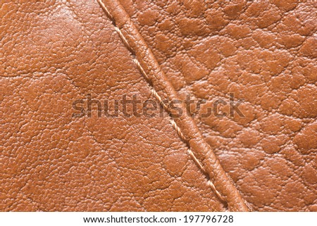 Brown leather with sew texture. - stock photo