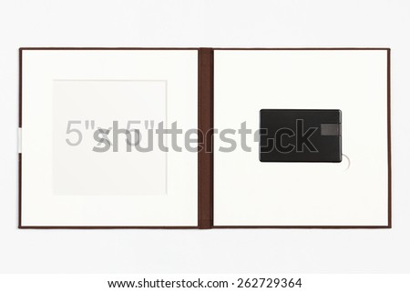 """Brown Linen USB Flash drive Folio, combined with a 5"""" x 5"""" image within a bevelled overlay wrapped in protective  paper. - stock photo"""