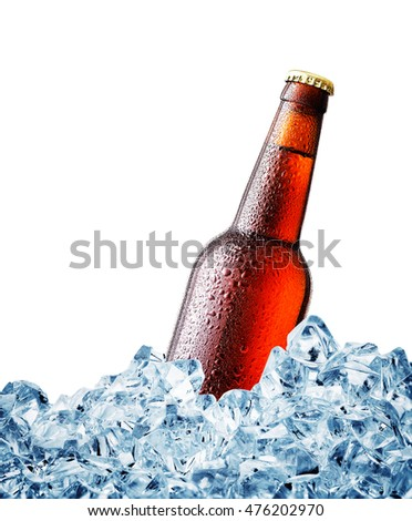 Brown misted over bottle of beer on ice isolated on white background