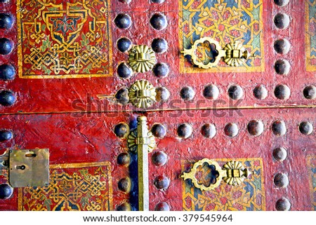 brown    morocco in    africa the old wood  facade home and rusty safe padlock