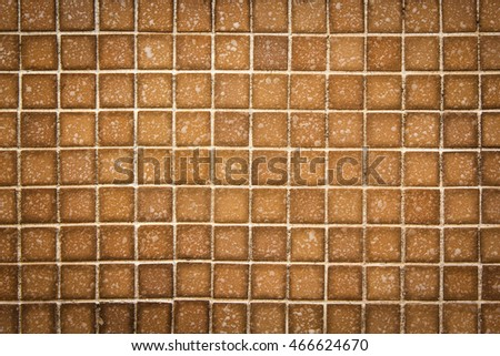 Brown mosaic wall texture and background