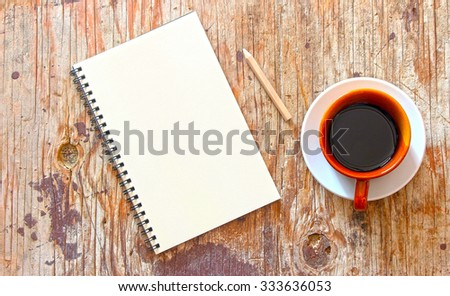 brown note book with coffee cup on grunge wood : HDR toning