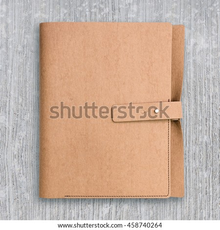 Brown notebook on concrete pattern texture background.