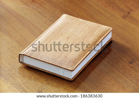 Brown notepad on a table - stock photo
