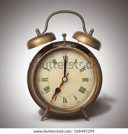 Brown old style alarm clock with shadow - stock photo
