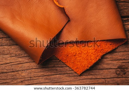 Brown, Orange Tan Leather, Concept and Idea Style of Fine Leather Crafting, Handcrafts, Handmade, handcrafted, leather worker. Background Textured and Wallpaper. Rustic Style. - stock photo