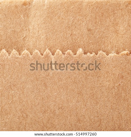 Brown packaging paper texture with seam as abstract background
