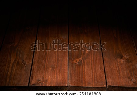 Brown paint coated wooden boards copyspace background composition with the low key lighting - stock photo