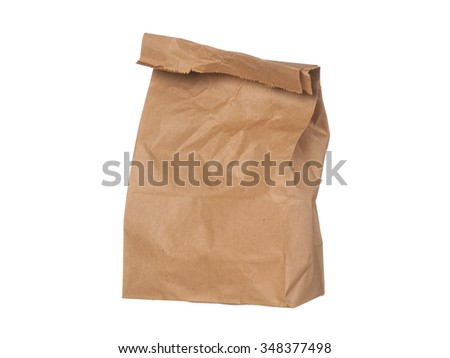 Brown paper bag closed standing isolated on white background