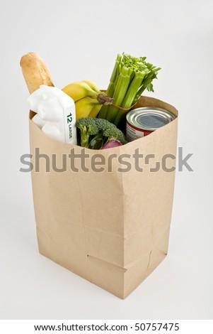 Brown paper bag full of groceries - stock photo