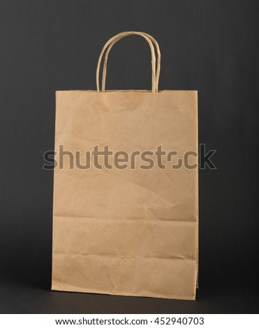 Brown paper bag  on a black background