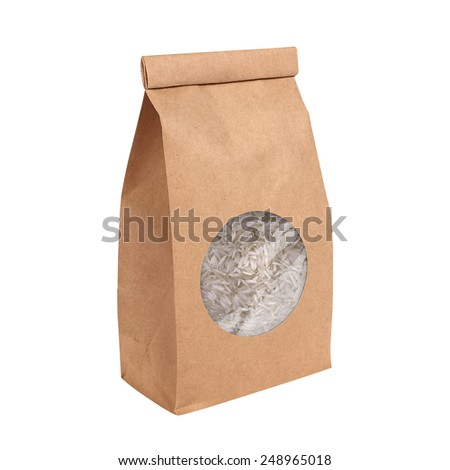 Brown paper bag with Basmati Rice isolated on white background. Clipping path included - stock photo