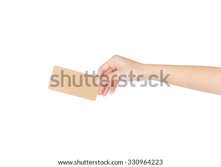 Brown paper card in female hand isolated on white with clipping path.