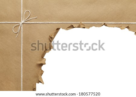Brown Paper Package with Rope Torn Open on White Background. - stock photo