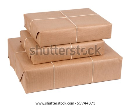 Brown paper packages tied up with string - stock photo