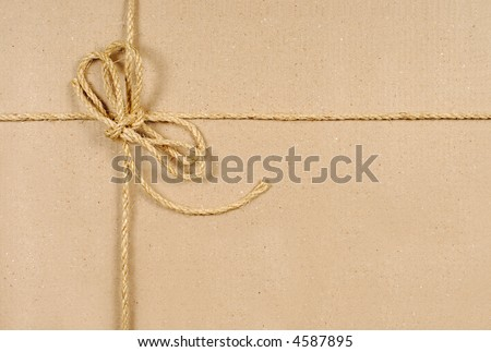 Brown paper parcel background with string and copyspace