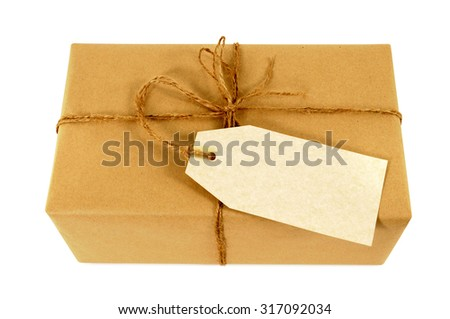 Brown paper parcel tied with string, blank label