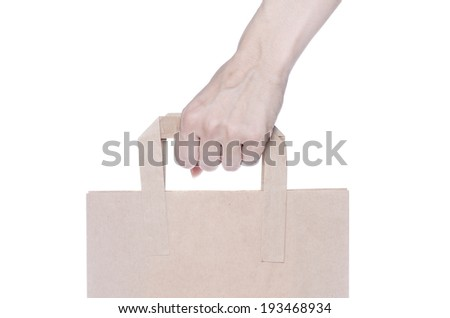 Brown paper shopping bag isolated on white background - stock photo