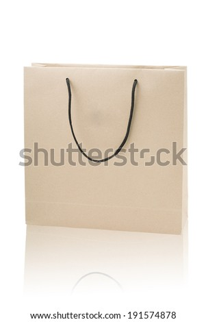 Brown paper shopping bag isolated with white background - stock photo