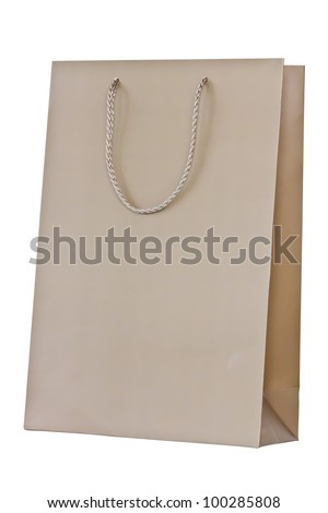 Brown paper shopping bag on isolated white background