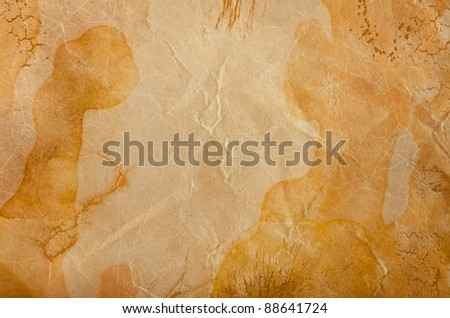 brown paper with bruises as an artistic background - stock photo