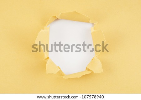Brown paper with hole - stock photo