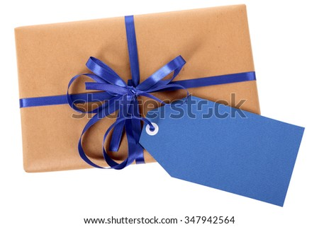 Brown paper wrapped package, blue gift tag label isolated on white, top view - stock photo
