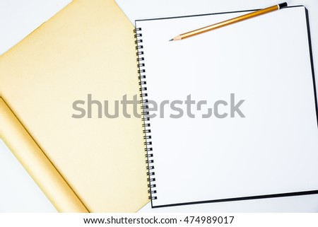 Brown pencil and blank paper copy space for background use