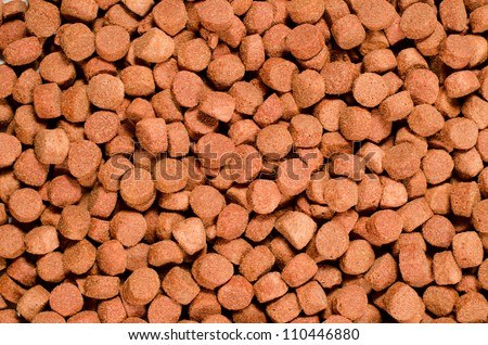 Brown pet food texture. Useful for backgrounds. - stock photo