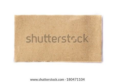 brown piece of ripped newspaper on white background - stock photo