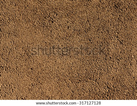 Brown plaster wall texture. Architectural background.