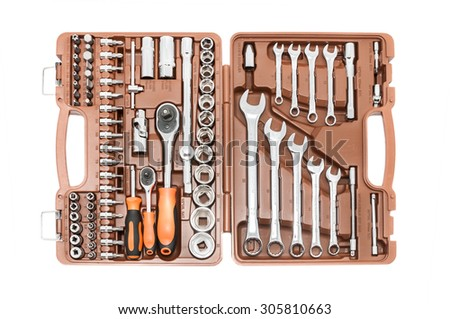 Brown plastic case with different tools. Isolated on white background.